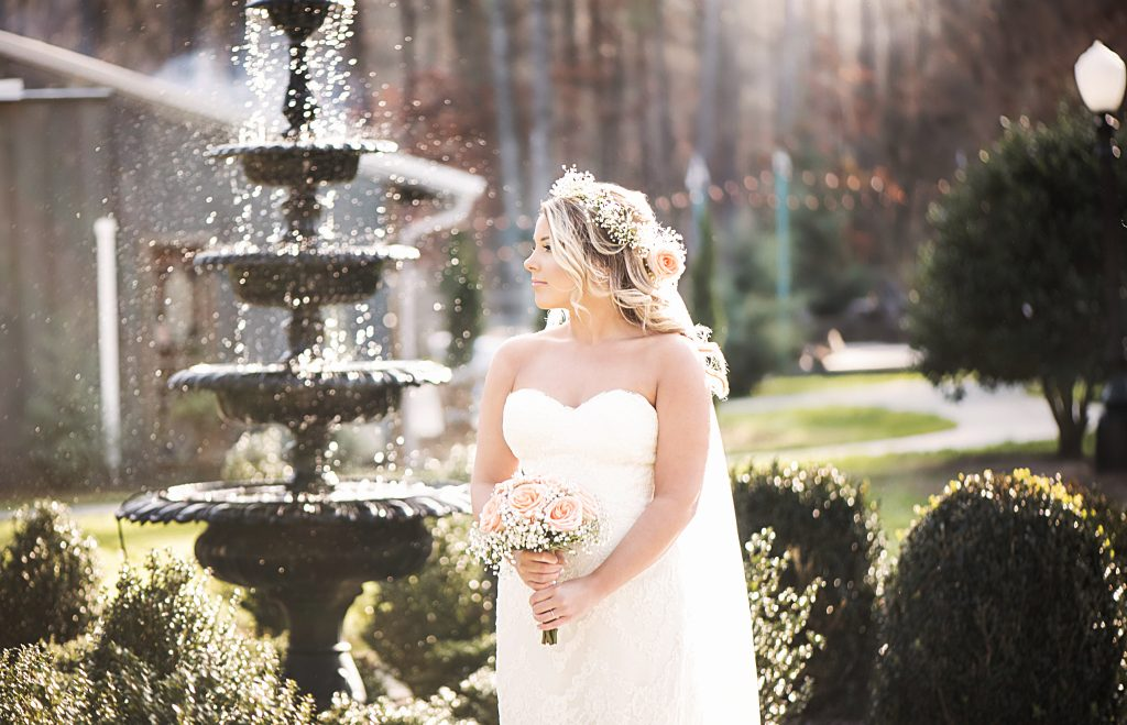 Bride in front a fountain
