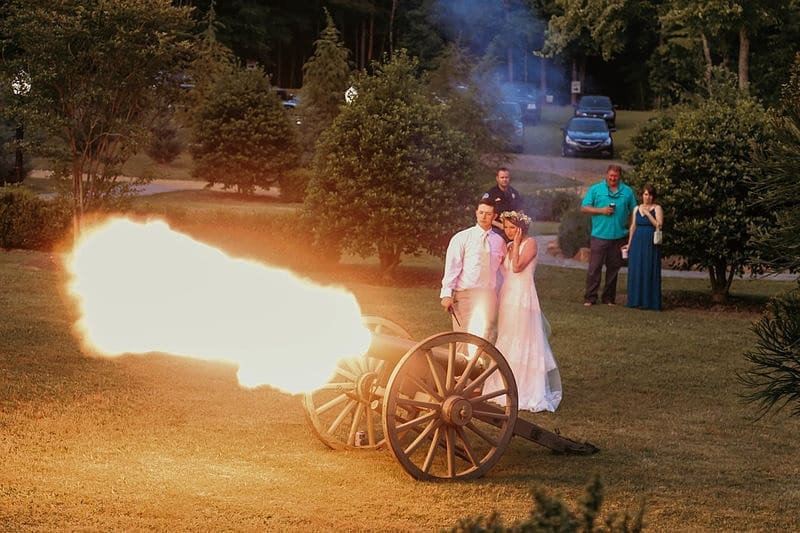 The bride and groom shooting the cannon